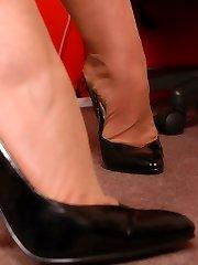 Angel at her office in skinny-skinned stockings