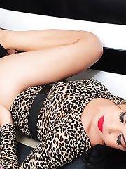 Busty Exotic TS Vitress Tamayo stripping on the sofa