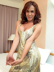 Fiery ladyboy Nance in a shiny gown shows cleavage