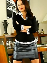 Sexy secretary Carla strips out of her smart top and naughty leather miniskirt.