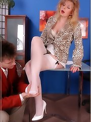 Secretary in milky pantyhose gives her co-worker a lustful job