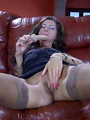 Horny chick spread-eagles on the leather sofa in tan stockings for toy fuck-a-thon