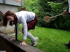 The carpet beater for a misbehaving schoolgirl