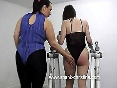Horny brunette spanked on her luscious ass in the gym - flaming red buttocks
