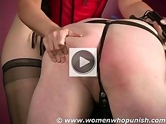 Male ass punishment by domina using her leather strap and crop