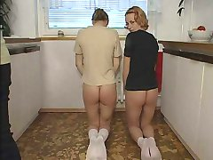 2 naughty girls spanked and severely caned in the kitchen - blistered butts