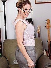 Handsome MILF Angela Attison undresses naked after work.