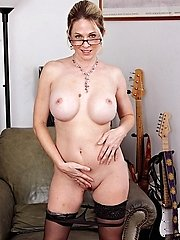 Handsome MILF Angela Attison undresses naked after work.
