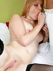 Hot platinum-blonde MILF Laura dons her pair of stockings and gets her snatch taken from behind
