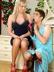 Cute sissy in a pretty blue dress going after a girl with a strap-on cock
