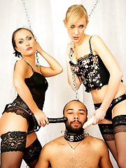 Before straponing their slave, Mistresses Lisa and Dasha make him suck their dildo as a dirty...