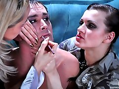 Cross-dressing guy getting made up for a strap-on fuck with his girlfriend