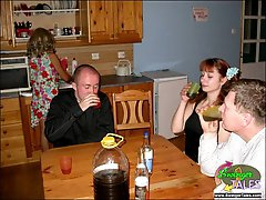 Drunken swingers fucking in kitchen