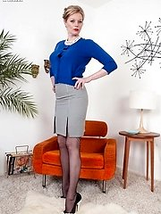 Holly flashes bootie in 60s black nylons on 60s easy chair!