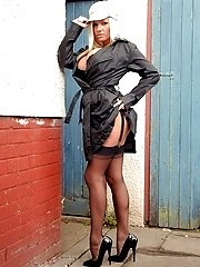 Michelle up to no good in her garden in kinky latex garter belt and Harmony point nylons!