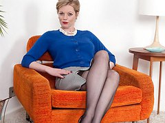 Holly shows ass in 60s black nylons on 60s easy chair!
