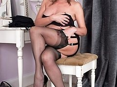 Silky hips Lou at her dressing table in stunning, shiny black slip!