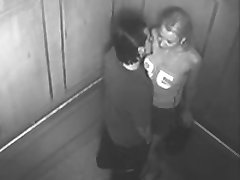 A pair bang in the elevator while the security camera films