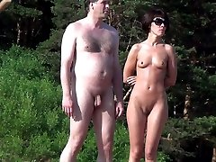 Naked couple continues something to discuss and inspect the neighborhood - may seek another couple for swinger fun party?