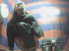 Two hotties urinates onto spy cam in public loo