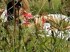 Topless sunbathing brunette filmed on voyeur cam