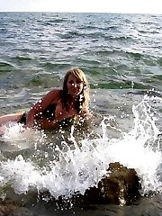 Lovely amateur blond came to the seaside to relax and bath in the warm sunshine topless. Check...