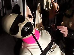 Female slave in skin-tight latex and rubber suit dominated by a hot Crimson Mansion mistress