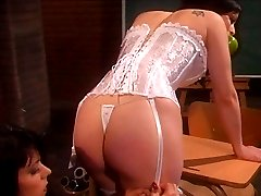 Apple-gagged female slave in sexy corset taking some nasty bare butt spanking from her mistress