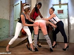 Annabelle Lee is minding her own business in the city when Aiden Starr and Nyomi Banxxx pluck her right off the street. They bring her back to an abandoned slaughter house where the leader of their gang Maitresse Madeline spanks, flogs, humiliates and clamps her tits. Annabelle is used like a piece of meat and made to give each of the girls orgasms by ass licking, pussy licking and dildo gag. Annabelle is hung upside down like a cold piece of meat and made to worship feet while having her pussy pounded to orgasm with a dildo. She's then wrestled down and fucked in both her holes at the same time till orgasm after orgasm is ripped from her cunt.