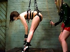 Maria Menendez returns under her new name Ryan Keely. Bound in tight latex bondage, she is...
