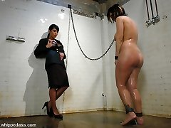 Chesty Claire Dames makes her debut at Whippedass submitting to Gianna Lynn.  This 36DD hottie plays a captive in the mitts of a perverted matron.  In shackles and chains, Claire is ordered to clean the filthy shower bedroom.  Not sated, Gianna punishes her with spankings.  She humiliates Claire by making her masturbate in the shower and eating food without utensils on the filthy box floor.  Then she is brought to the matron's chamber at night, trussed and forced into sexually service with vulva and culo licking.  Lastly, Gianna fucks her in the butt while making Claire cum with a intense vibrator.