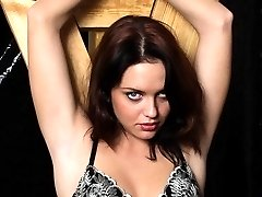 Pretty brunette in rope bondage gets clasps on pussy lips and nipples