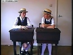 Pretty school girls pull up their gymslips for a hard spanking over the prefect's knee