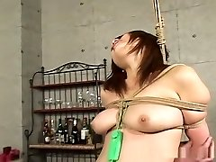Hot superslut hogtied and swaying with hot wax on her ass!