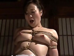 Attractive Japanese Yu Kawakami in bondage pornography