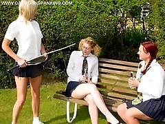 Caned on her big fat ass in the garden - deep welts and stripes