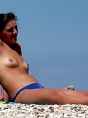 Check out this nudist showing off her shaved pussy