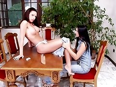 Tattooed dark-haired hotties in lustful lesbian play on top of the table