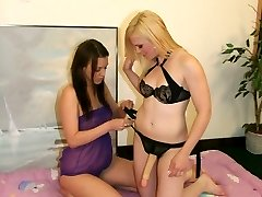 Sexually Aroused lesbians Amber and Deja strips and shares a large strapon