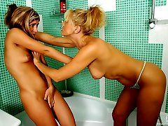 Nasty filly spying on a milf in the shower joining her for wet making out