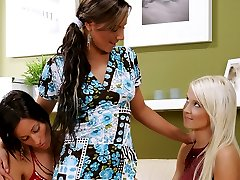 Three long legged lesbians kissing