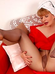 Angel in grey colored, shiny and sheer pantyhose