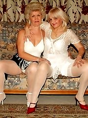 Sexy older gals Francesca and Erlene show off their flabby fat butts and sharing a pussy toy