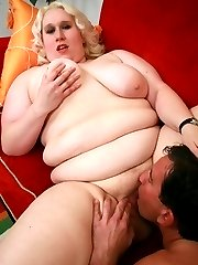 Blonde BBW model Tina Rose slobbering a thick cock while playing with her fat tits live