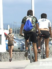 Chiki Dulce is a disgusting exhibitionist that needs to be objectified. Running down the beach in a mesh dress, Chiki flaunts her tight little body as people stop to watch her perky ass bounce by. Mona spots this whore from a mile away and readies her trap as the unsuspecting slut jogs ever closer. Once Chiki is within striking distance Mona pounces on her prey. Mona instantly slut shames Chiki into submission and commands her to strip naked. A wave of shame washes across her face as she realizes how many people are staring at her unveiled body.