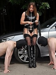Mistress Carly has her slaves worship her dirty leather boots and lick her sexy bare feet,...