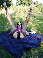 Jane outdoors in pink negligee covering huge strapon