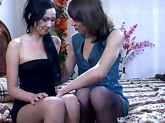 Horny lesbo in dark back seam tights seduces a shy girl into wet pussy play
