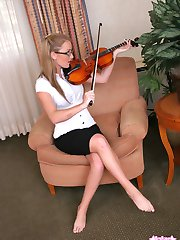 Kates sexy stunning girlfriend Abbie shows off her classical side as she plays her violin before...