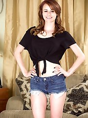 Sage Evans bounces on her big black dildo.